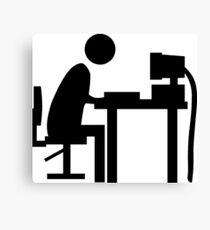 Man sitting at an office desk. Canvas Print