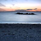 Sun set on a beach by Manuel Gonçalves