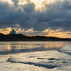 Bamburgh Lighthouse Under A Moody Sky. by Dave Staton
