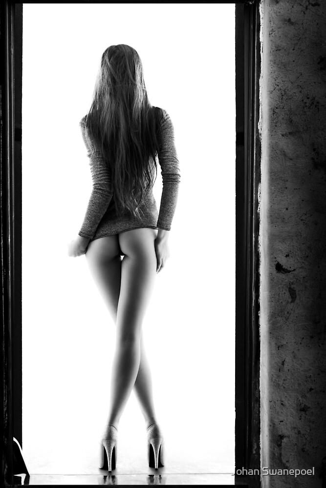 Woman standing in doorway by Johan Swanepoel