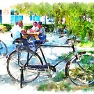 Albania: bicycles with men sitting at the table in a Fier park by Giuseppe Cocco