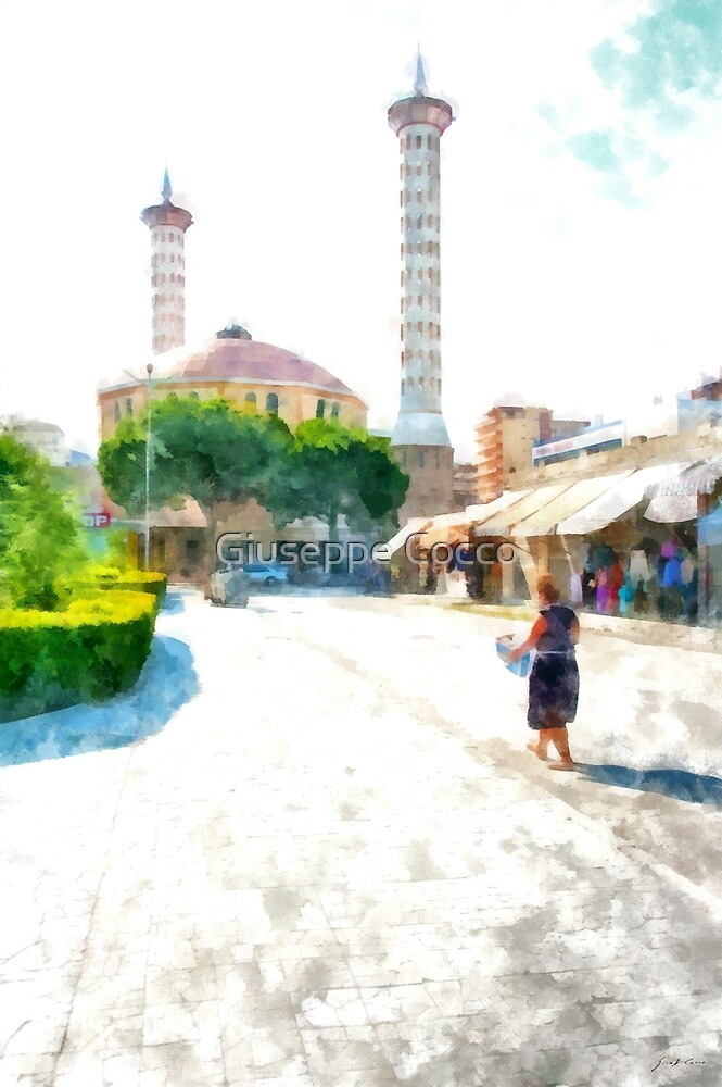 Albania: woman walks towards the Fier Mosque by Giuseppe Cocco