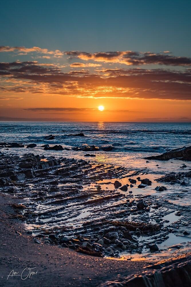 Sunrise over the ocean by Aiin Ojani
