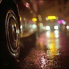 Cars in urban street on rainy night hasselblad medium format analog film photograph by edwardolive
