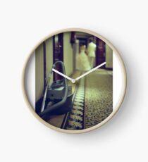 Wedding bride and groom and vacuum cleaner in hotel corridor Clock