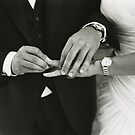 Bride and groom exchanging wedding rings in mariage ceremony black and white analog 35mm film photo by edwardolive