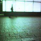 Man walking in city street Hasselblad medium format analog film by edwardolive