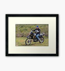 On His Bike. Framed Print