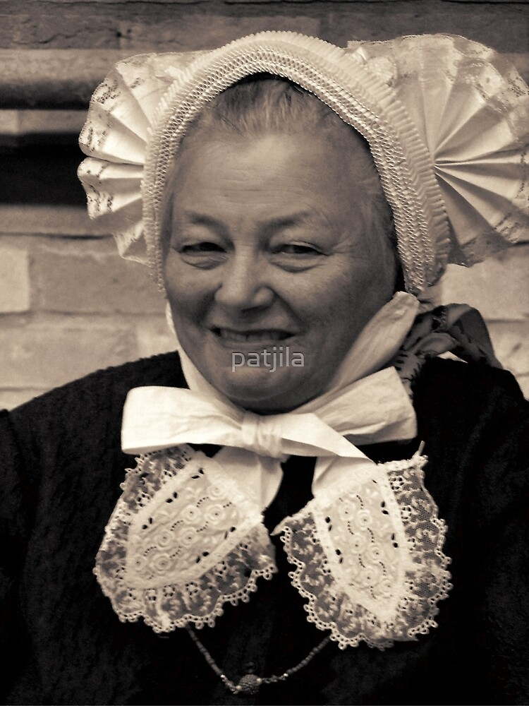 A lovely lady wearing a traditional Dutch Salland's pleated ruffled hat by patjila