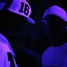 Hip hop rap gangster rappers singers at night in dark nightclub bar lit in pink black light wearing baseball caps by edwardolive