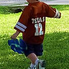 A boy with his frisbee 2 by Jenni Atkins-Stair