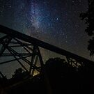 Railroad Trestle against the stars by Sam Noble