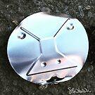 Faccia di coperchio di barattolo di latta by SilviaDallaDea