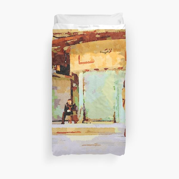 Woman and man sitting on a chair in Aleppo street Duvet Cover