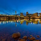 Portland OR downtown city skyline by Hawthorne Bridge from Eastbank Esplanade at evening blue hour by davidgnsx1