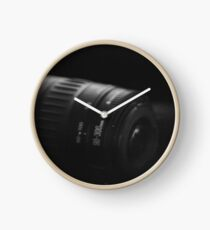 Camera lense in darkness Clock