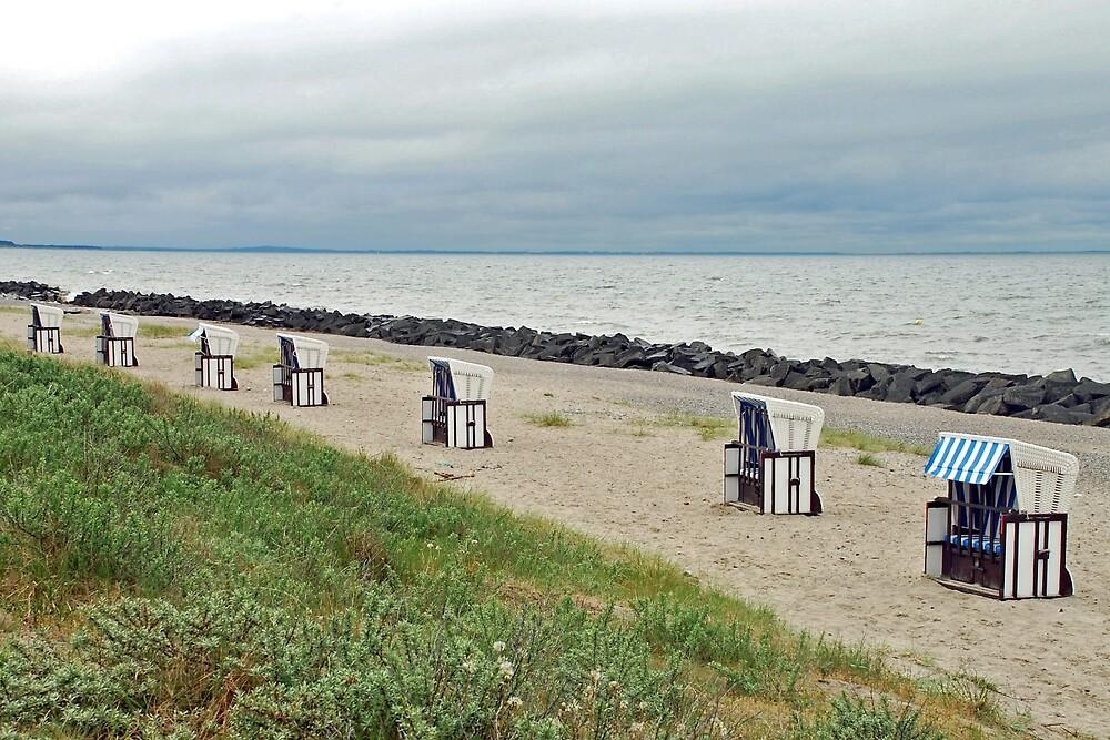 Empty beach chairs by Arie Koene