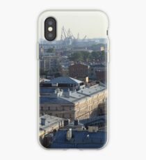 Building roofs cityscape scenery with cranes on the horizon. iPhone Case