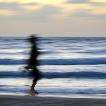 Motion blurred jogger on a beach at sunset  by PhotoStock-Isra