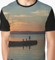 Fisherman in silhouette on the Pontile Degli Spagnoli at dawn, Castiglione del Lago, Umbria, Italy Graphic T-Shirt