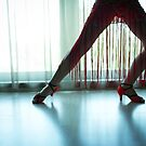 Woman legs in dancing pose by GemaIbarra
