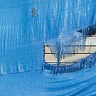 Torn blue tarp  by Merrimon