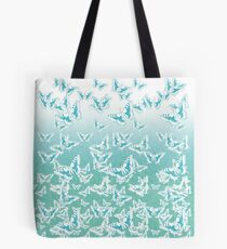 blue butterflies in the sky Tote Bag