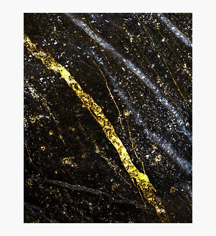 Gold sparkly line on black rock Photographic Print