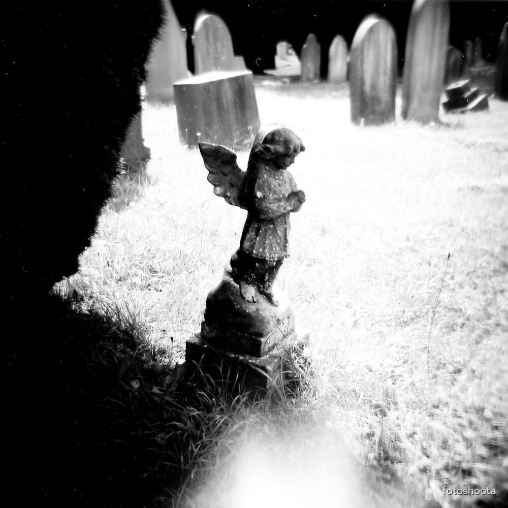 Small stone angel by fotoshoota