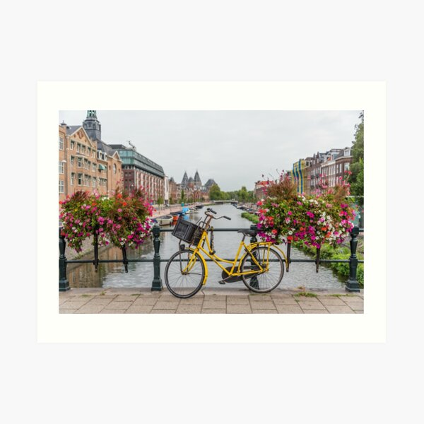 Yellow Bicycle and Flowers on a Bridge in Amsterdam Netherlands Art Print