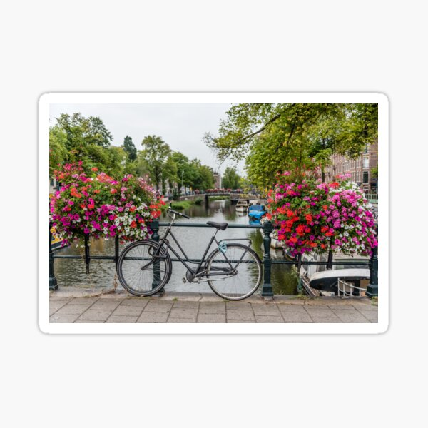Bicycle and Flowers on a Bridge in Amsterdam Netherlands Sticker