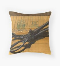 vintage pinking shears sitting on a taped box Throw Pillow