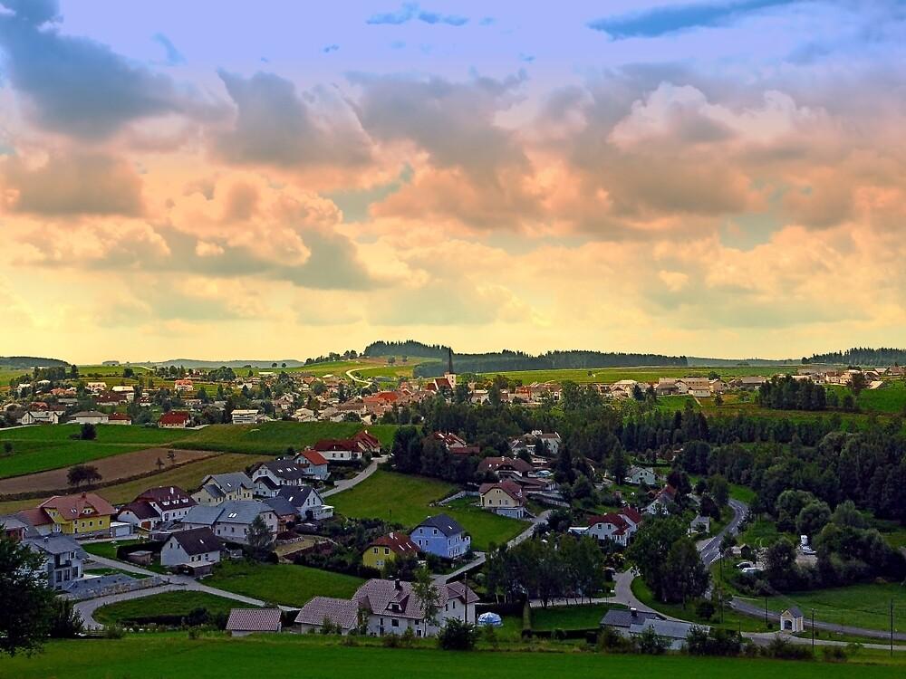 Beautiful village skyline beyond cloudy sky   landscape photography by Patrick Jobst