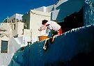 Wash Day in Oia by Yuri Lev
