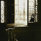 Chair by the window by OntheroadImage