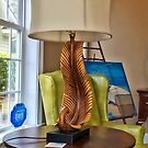 Lamp next to a Chair by TJ Baccari Photography