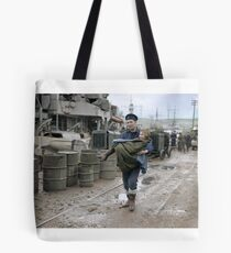Norwegian child being carried to an ambulance from HMS Onslaught at Gourock, 1 March 1945 Tote Bag