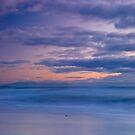 Mount Taranaki viewed from theTaranaki Coast at sunset by Paul Mercer