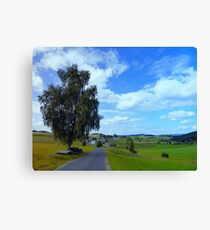 Old tree, country road and a cloudy sky | landscape photography Canvas Print