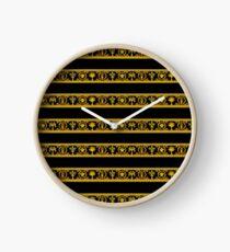 Reloj barocco rasguños dorados