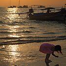 Curious Girl on Beach by Gene  Tewksbury