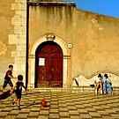 Playing in Taormina by Silvia Ganora