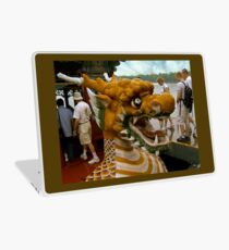 Into the Belly of the Dragon Boat Laptop Skin