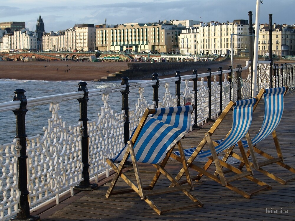 Deck chairs on Brighton Palace Pier by leilani-a
