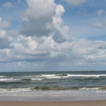 Borkum Germany Northern beaches dramatic clouds over the North Sea Coast. by stuwdamdorp