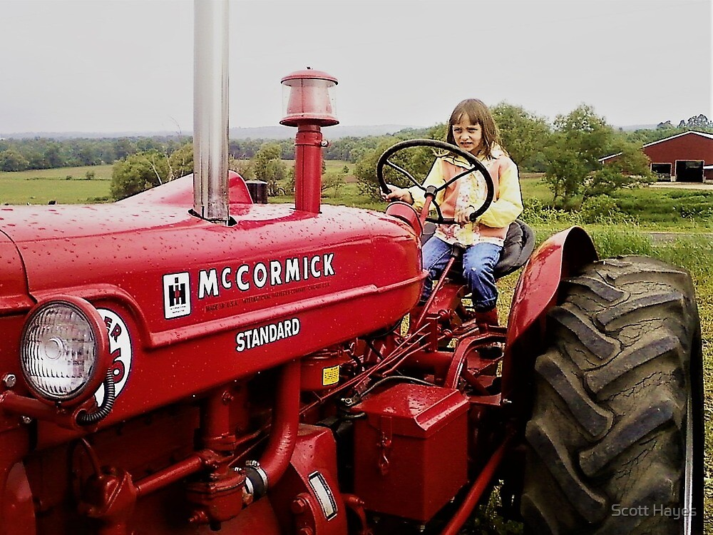 A country girl on a tractor. by Scott Hayes