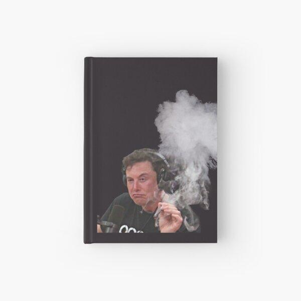 Elon Moschus raucht Notizbuch