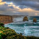 Sun setting over the twelve apostles in landscape by Elana Bailey
