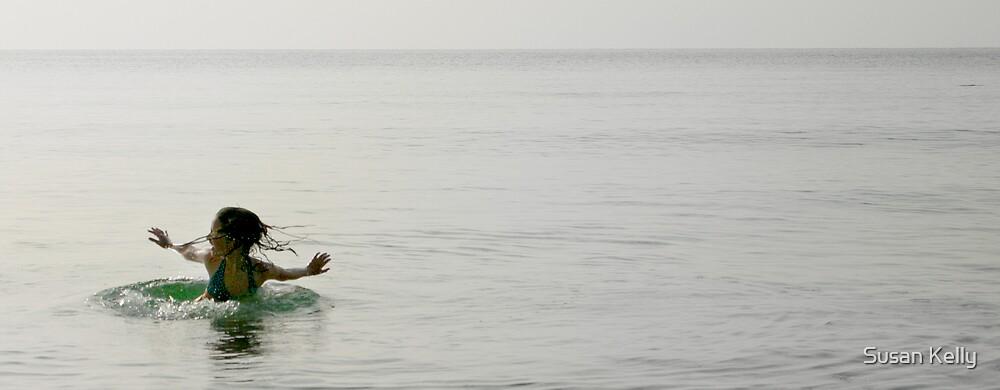Smooth sea fun, Bingil Bay beach QLD. by Susan Kelly