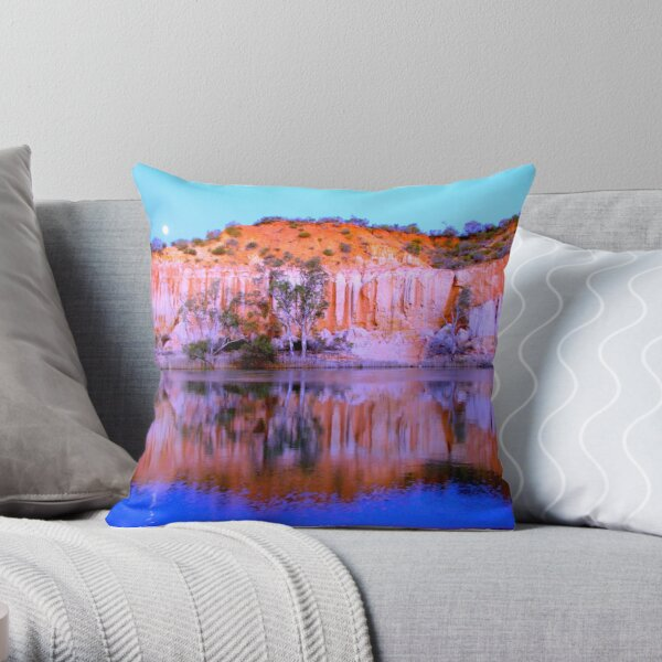 Golden limestone cliffs at sunset on the River Murray with a full moon rising Throw Pillow